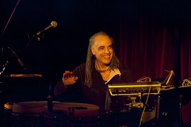 French percussionist Mino Cinelu led his World Jazz Ensemble, also picking up an electric guitar in the process.